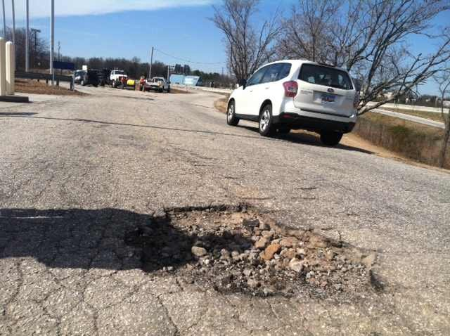 pothole on St. Joseph Dr. in Greenville (Fox Carolina)