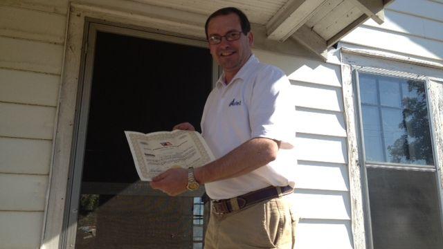 Rocky Burgess shows us the certificate he found (Fox Carolina)