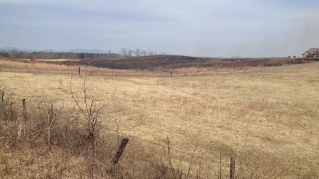 Scorched field after fire on Jordan Rd. (Fox Carolina)