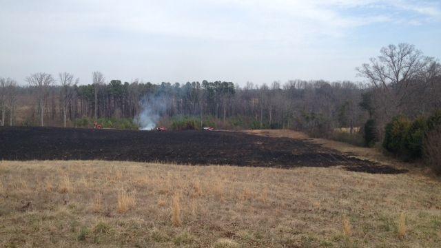 Firefighters douse hot spots after fire on Jordan Rd. (Fox Carolina)