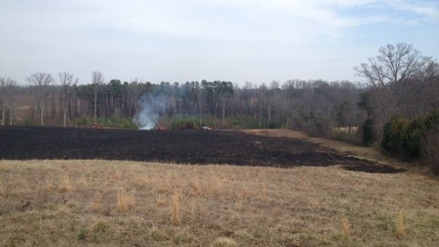 Firefighters douse hot spots after fire on Jordan Rd. (Fox Carolina)