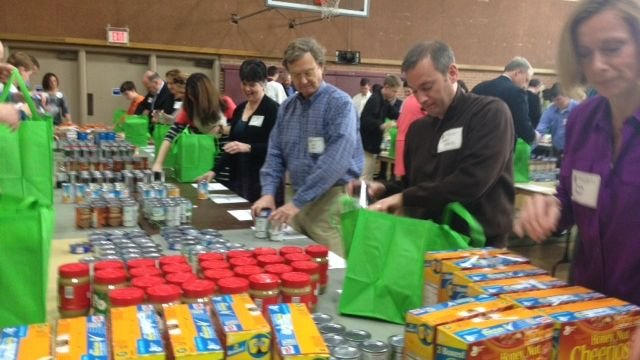 Members of Christ Church Episcopal bag food (Fox Carolina)