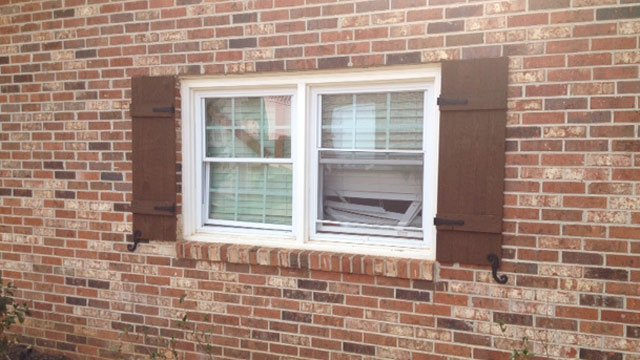 A broken window at the Kingsley Dr. home. (March 5, 2014/FOX Carolina)