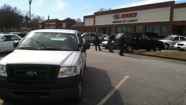 Police respond to the GB Shoes after the reported shoplifting. (March 5, 2014/FOX Carolina)