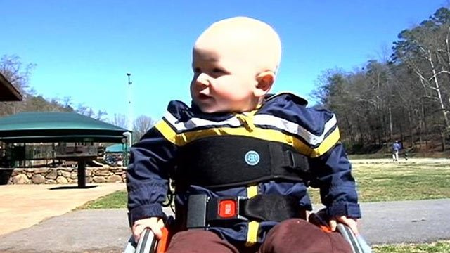 Wyatt wheels around Cleveland Park with his new wheelchair. (March 13, 2014/FOX Carolina)