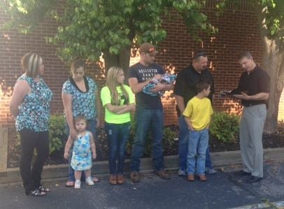 N. C. Rep. Mike Hager (right) honors Timothy Tesseneer (second from right) alongside his family. (FOX Carolina)