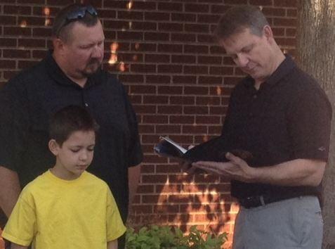 N. C. Rep. Mike Hager (right) honors Timothy Tesseneer. (FOX Carolina)