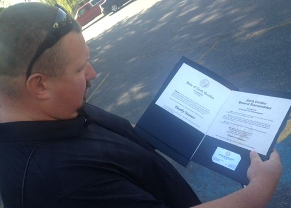 Timothy Tesseneer admires the official declaration from the state. (FOX Carolina)