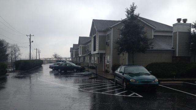 Deputies investigate a woman's death at the Mauldin Road hotel. (March 16, 2014/FOX Carolina)