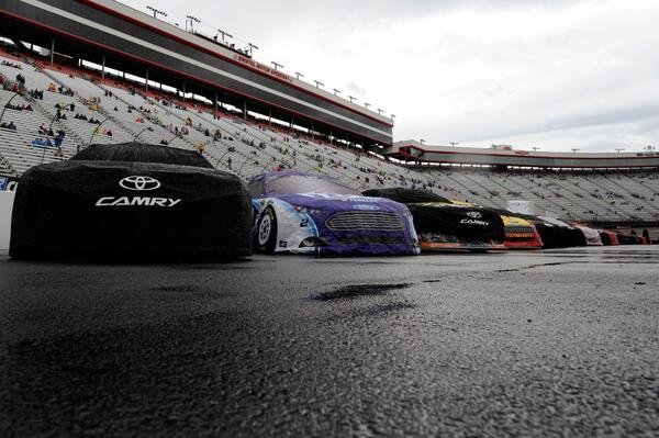 Covered cars on wet track (Courtesy: Fox Sports/ NASCAR/ Twitter)