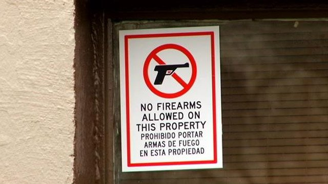 New signs posted in the window at Backstreets after the controversial sign was taken down. (March 18, 2014/FOX Carolina)