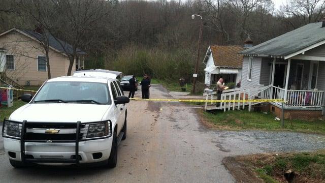 Deputies investigate the shooting along Finley Street. (March 19, 2014/FOX Carolina)