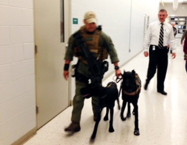 Sheriff Chuck Wright (L) with Capt. Joseph Garcia and the K9s. (March 24, 2014/FOX Carolina)