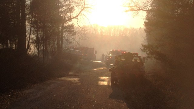 The fire also burned a wooded area nearby. (March 27, 2014/FOX Carolina)