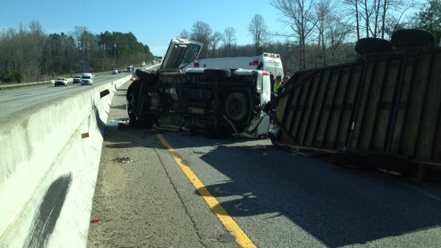 The overturned truck hauling a trailer. (March 31, 2014/FOX Carolina)