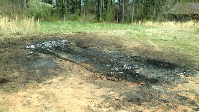 The ground where the car burned was still scorched on Wednesday. (April 2, 2014/FOX Carolina)