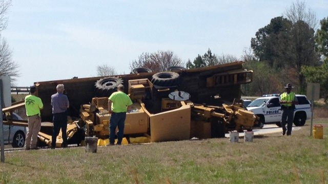 The overturned truck and trailer blocking the ramp. (March 2, 2014/FOX Carolina)