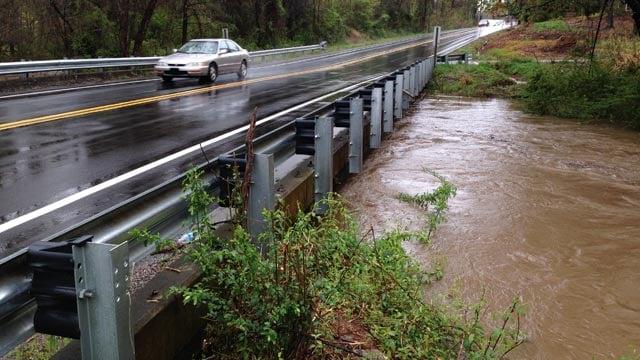 Brushy Creek rises up to bridge along Old Boiling Springs Road. (April 7, 2014/FOX Carolina)