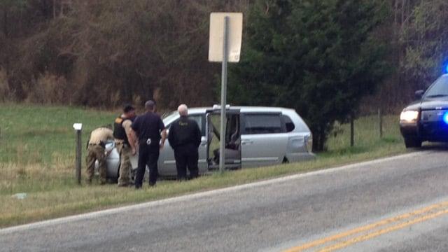 Deputies search the suspects' van. (April 3, 2014/FOX Carolina)