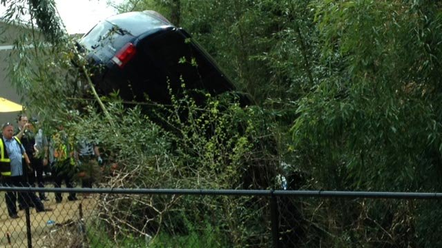 The SUV is towed up from the creek. (April 8, 2014/FOX Carolina)