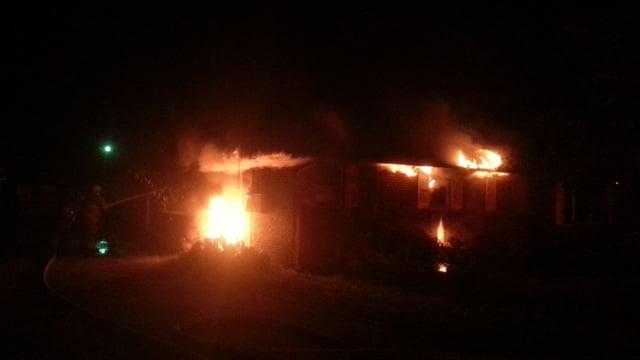 Firefighters work to take down the fire. (April 10, 2014/FOX Carolina iWitness Meg M.)
