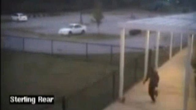 Surveillance footage of the suspect released by police in 2013. (Source: Greenville PD)