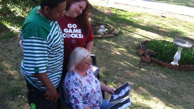Shannon's family look at photos of her on Thursday. (April 10, 2014/FOX Carolina)
