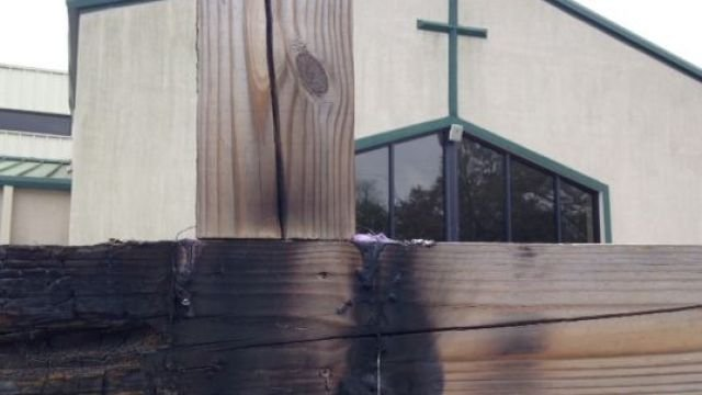Deputies investigate burned cross at a Spartanburg church. (April 14, 2014/FOX Carolina)