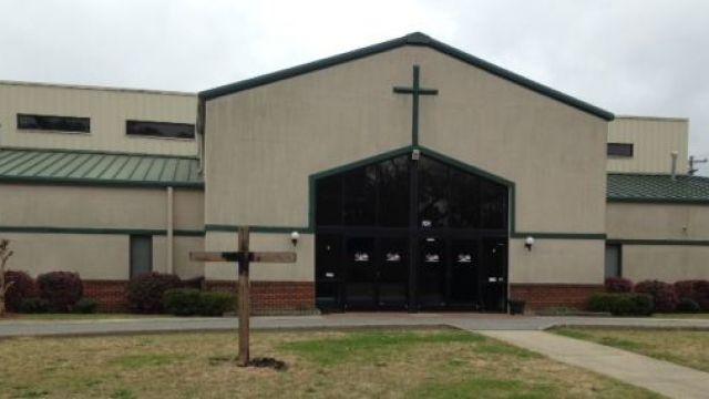 Deputies investigate burned cross at a Spartanburg church. (April 14, 2014/FOX Carolina)