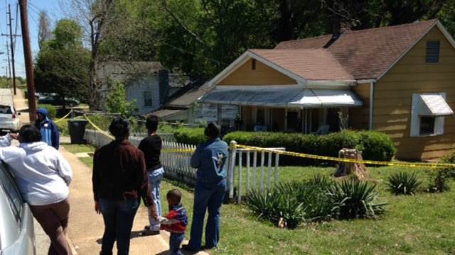 Family gathered outside of Davis' Union Boulevard home. (April 16, 2014/FOX Carolina)