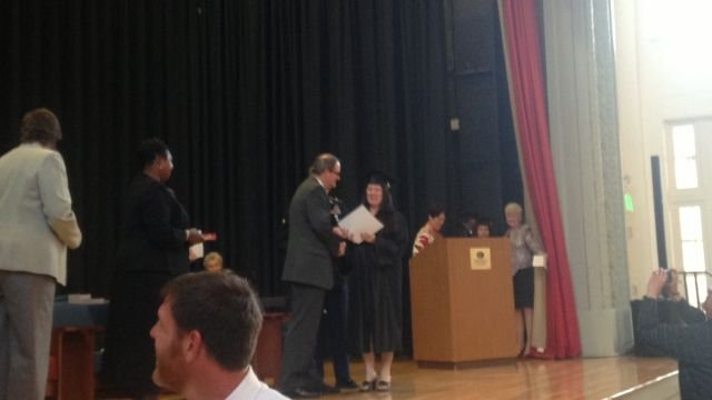Dona Shreve receives her GED during a surprise escort by her son. (April 17, 2014)