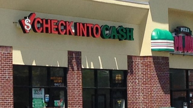 Police say the men tried to enter this Check Into Cash store. (April 21, 2014/FOX Carolina)