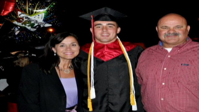 A family photo of Thompson with his parents at graduation. (Courtesy: Thompson family)
