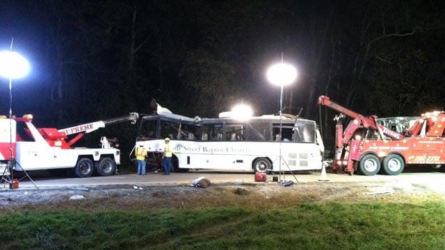 Emergency crews work to tow away a church bus after the fatal I-40 crash. (Oct. 3, 2013/FOX Carolina)