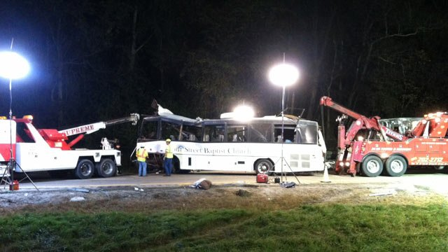 Emergency crews work to tow away a church bus after the fatal I-40 crash. (Oct. 3, 2013/FOX Carolina)