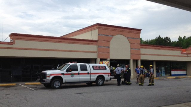 Firefighters and emergency personnel clean-up after the fire and explosion. (April 28, 2014/FOX Carolina)