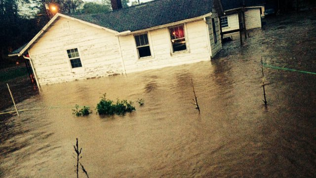 Flood waters surround a Woodfin home. (April 29, 2014/FOX Carolina)