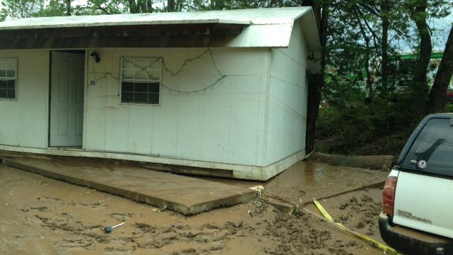 NC residents cleaning up after flood, where a home was pushed of its foundation. (April 29, 2014/FOX Carolina)