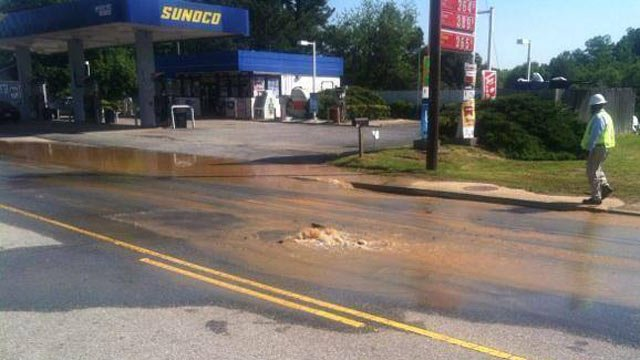 Water bubbles up through Union Street. (May 5, 2014/Spartanburg PD Facebook)