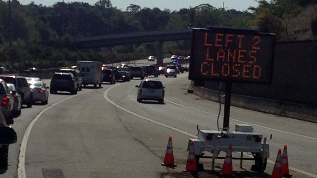 A sign warns drivers of the lane closures as they merge onto I-385 from downtown and from Stone Ave. (May 6, 2014/FOX Carolina)