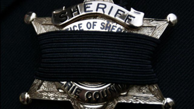 Sheriff badge with black fabric covering to honor fallen officer. (File/Associated Press)