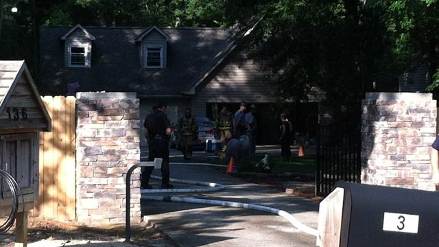 Firefighters and deputies at a Riley Smith Drive home that caught fire. (July 27, 2012/FOX Carolina)