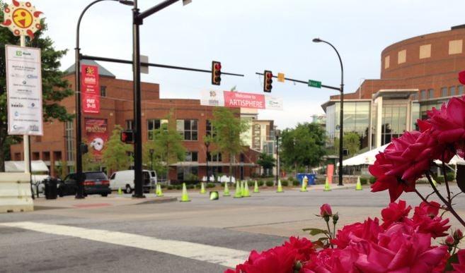 Crews hang signs for Artisphere on Friday morning (FOX Carolina)