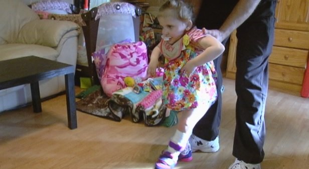 Karleigh Stone, 2, working with a therapist to walk (FOX Carolina)