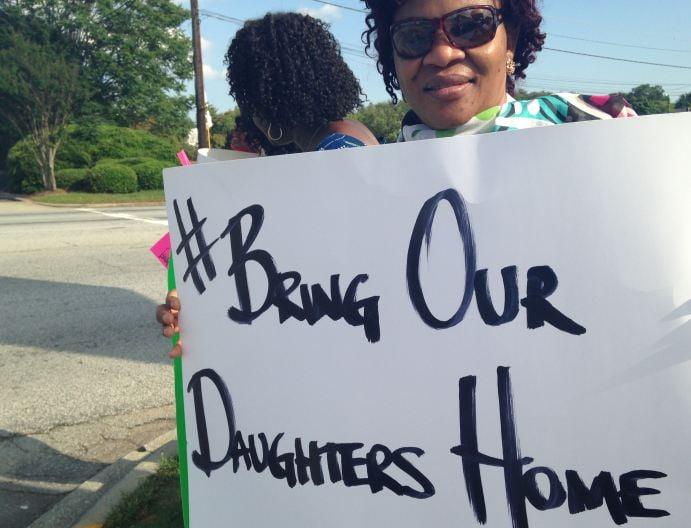 Demonstrators rally in Greenville (FOX Carolina)