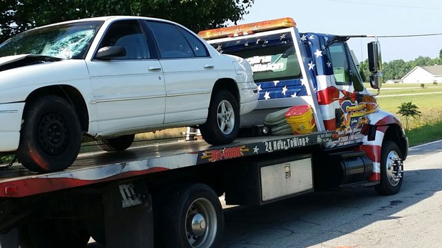 A car is towed from the scene of the wreck along Wilkinsville Highway. (May 13, 2014/FOX Carolina)