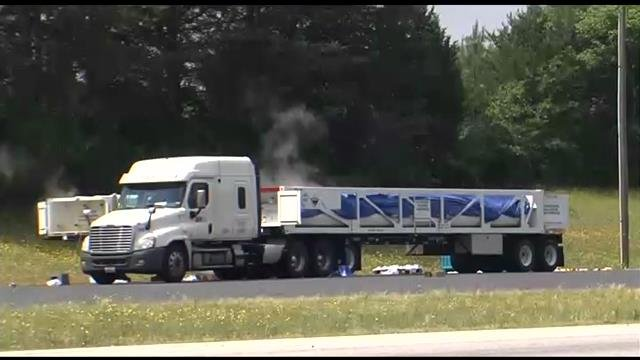 Acid vapors rise above the leaking truck as it is transferred. (May 14, 2014/FOX Carolina)
