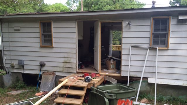 The damaged back of the victim's home. (May 14, 2014/FOX Carolina)