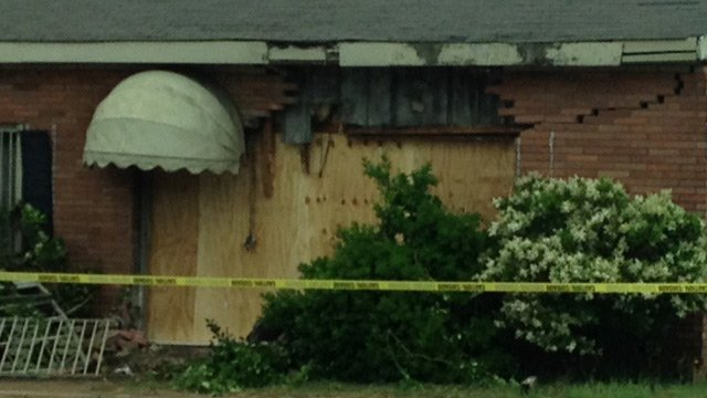 Damage to the shop is covered up with plywood. (May 15, 2014/FOX Carolina)