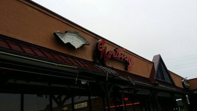 Fire damage to the sign and awning of Monterrey's on Woodruff Road. (May 15, 2014/FOX Carolina)